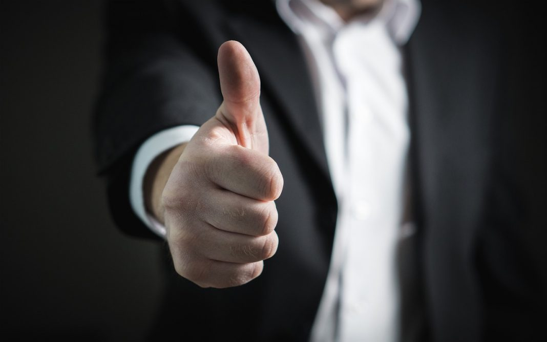 a man giving a thumbs up gesture