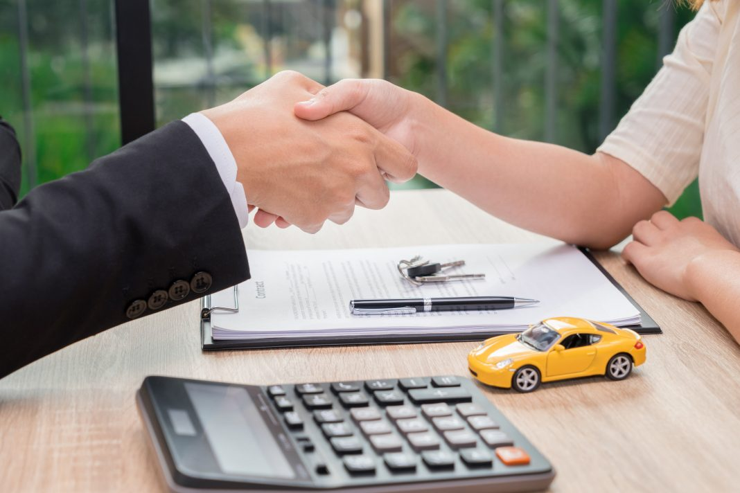 A handshake signifying a completed loan deal
