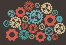 Multiple coloured gears forming a system