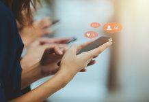 Social media users on their phones