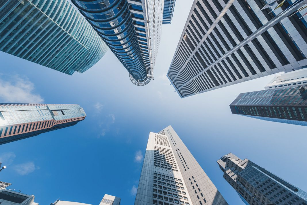 Tall buildings as seen from the ground.