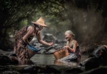An act of kindness by a male to a female in rural Thailand