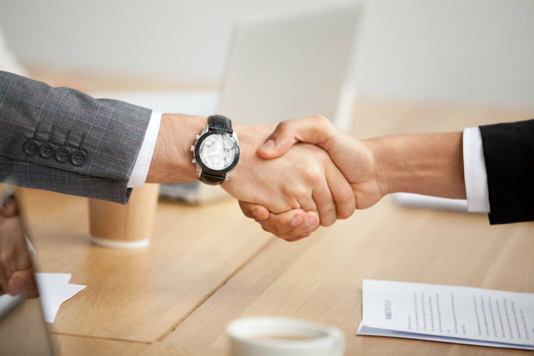 Closeup view of a handshake between business partners