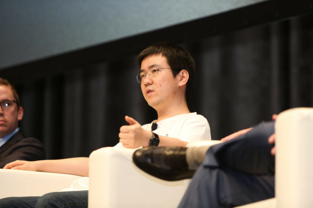 Jihan Wu, co-founder of Bitmain, speaking at a conference