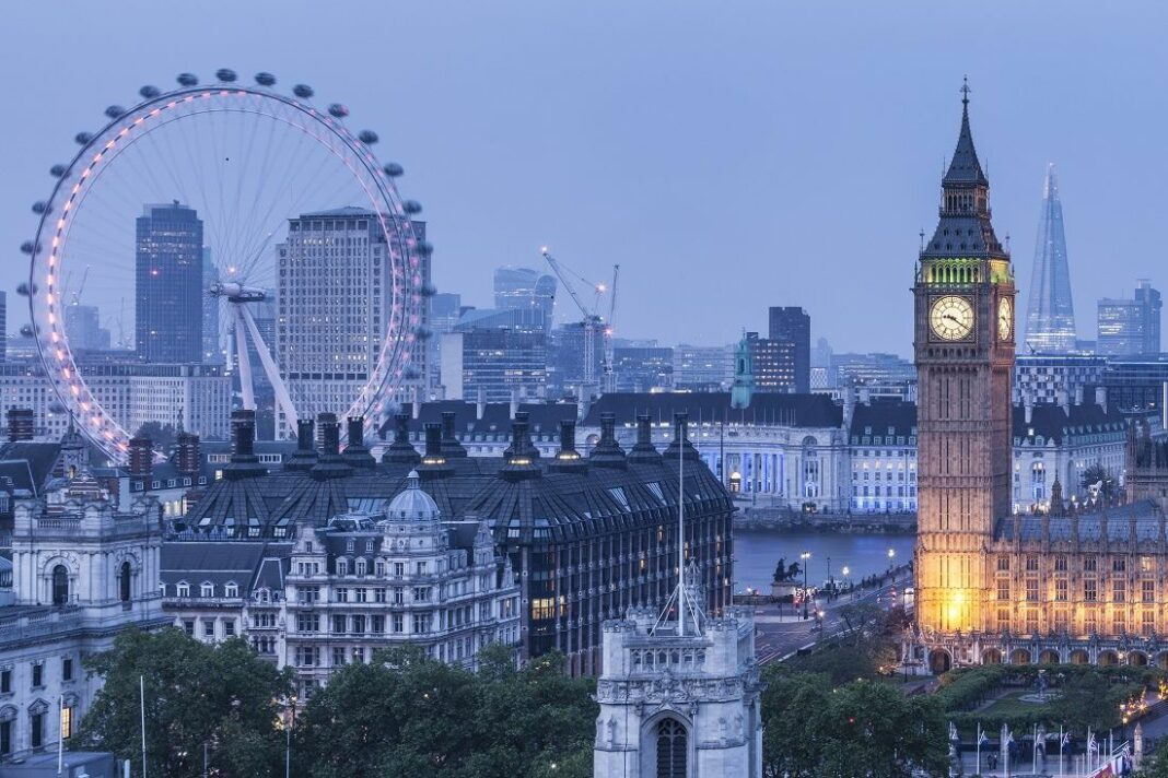 View of the London skyline, featuring the Coca Cola London Eye towers above Westminster