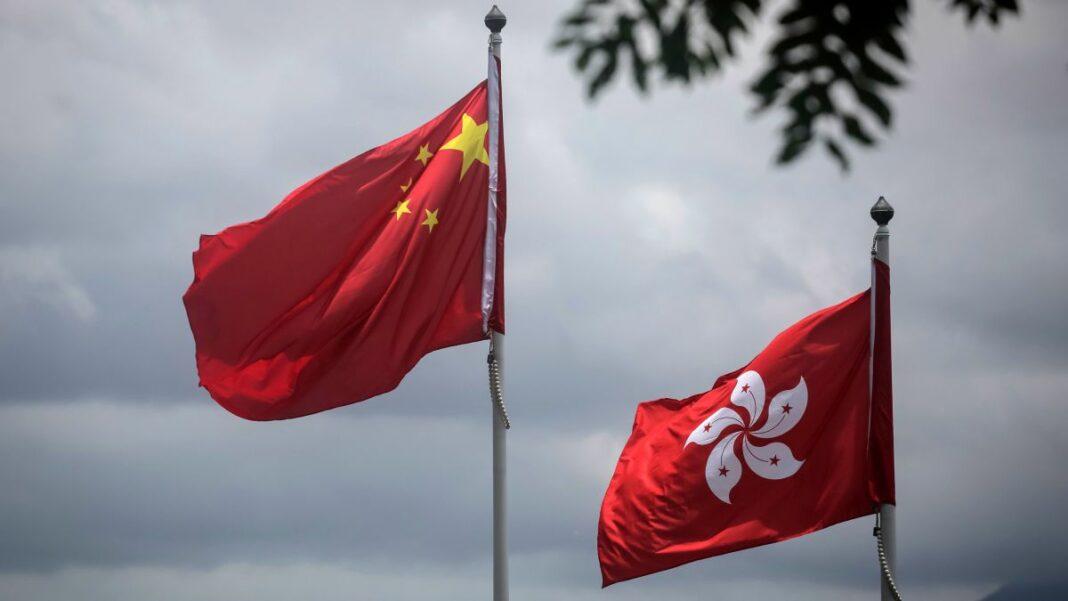 The national flags of China and Hong Kong
