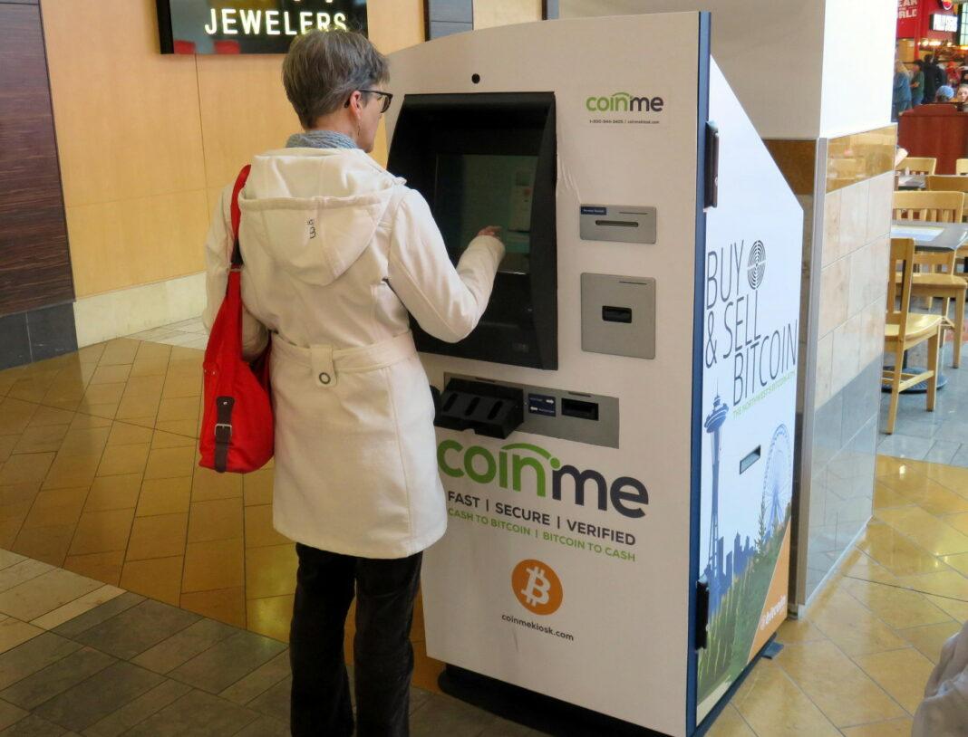 Woman using a Coinme Bitcoin kiosk