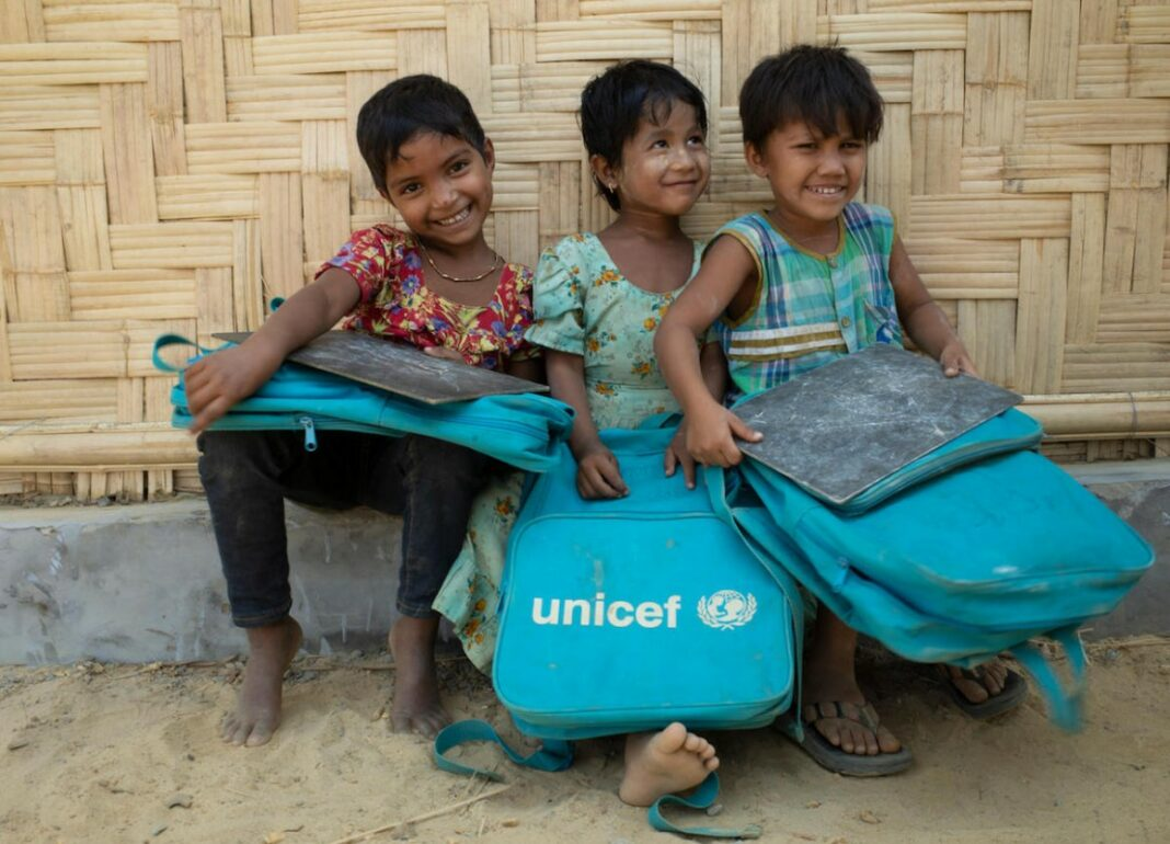 Children holding UNICEF bags