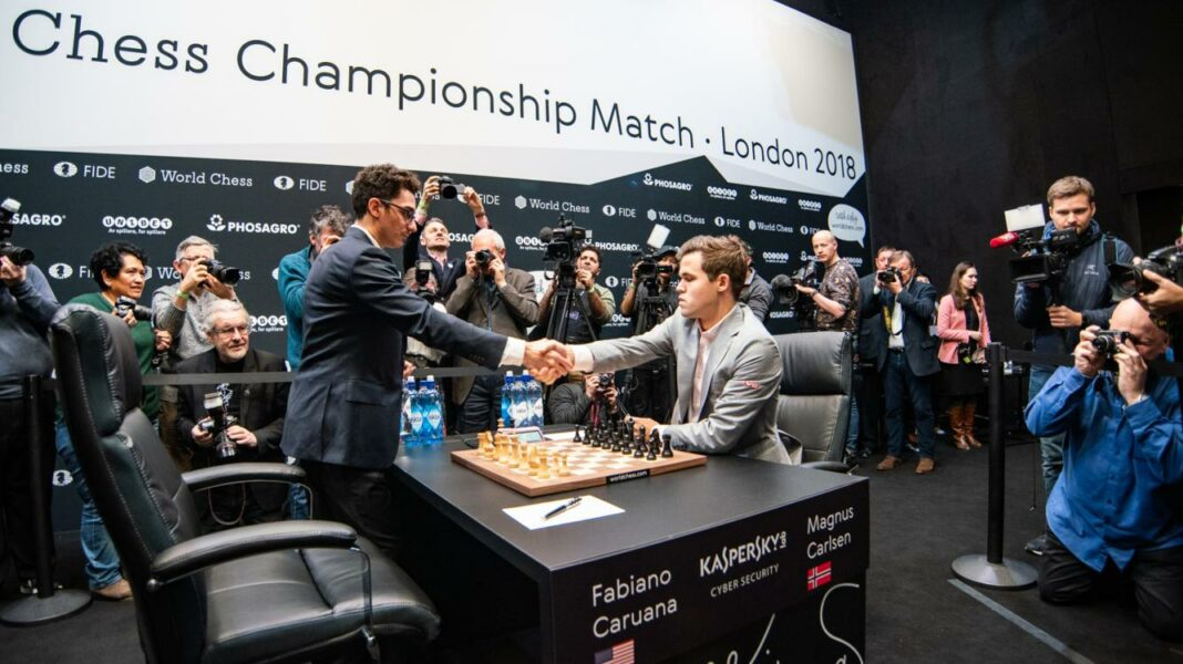 Magnus Carlsen and Fabiano Caruana shaking hands after game 12 of the World Chess Championship