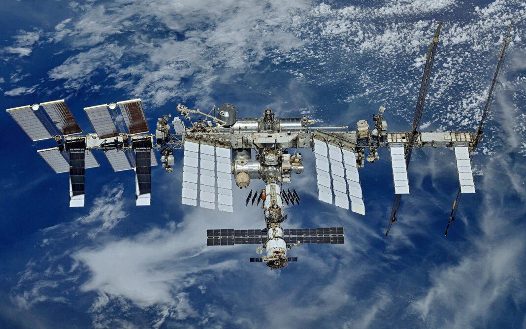 Picture of the International Space Station (ISS) hovering over our beautiful planet
