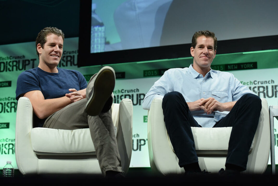 Tyler and Cameron Winklevoss speaking at the TechCrunch Disrupt