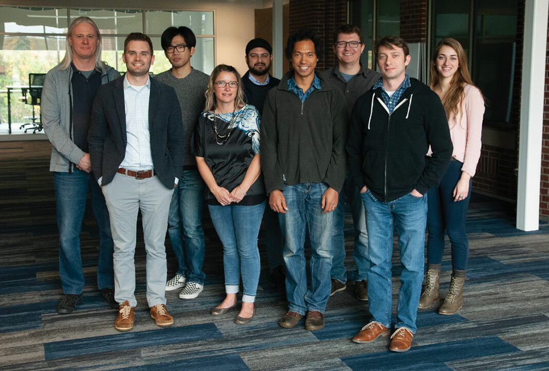 The SIMBA Chain team, with CEO Joel Neidig standing second from left to right