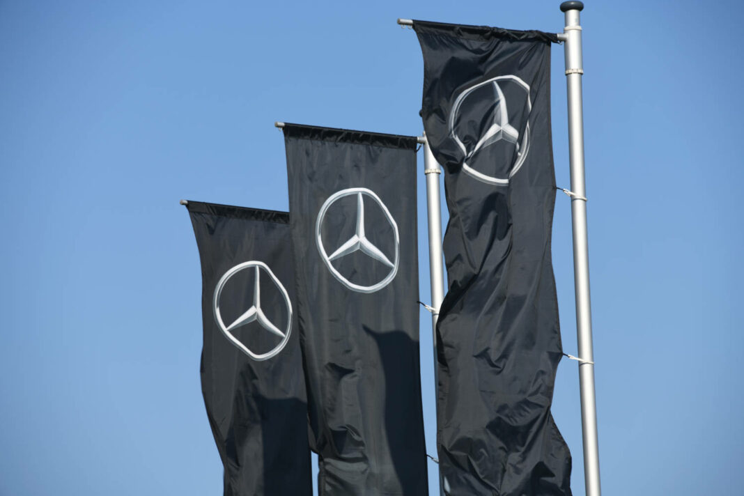 Flags at the entrance of a Mercedes store