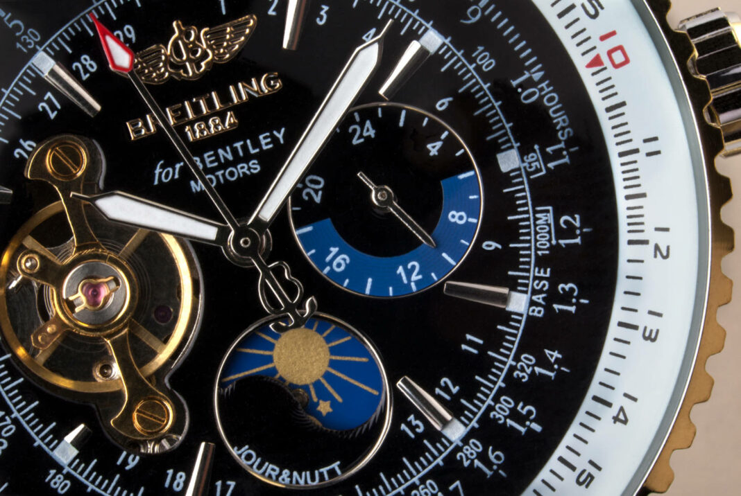 Close up of an expensive Swiss-made Breitling chronograph wristwatch
