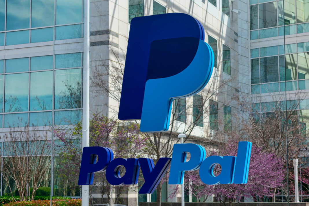 PayPal logo and sign in front of PayPal Holdings headquarters building