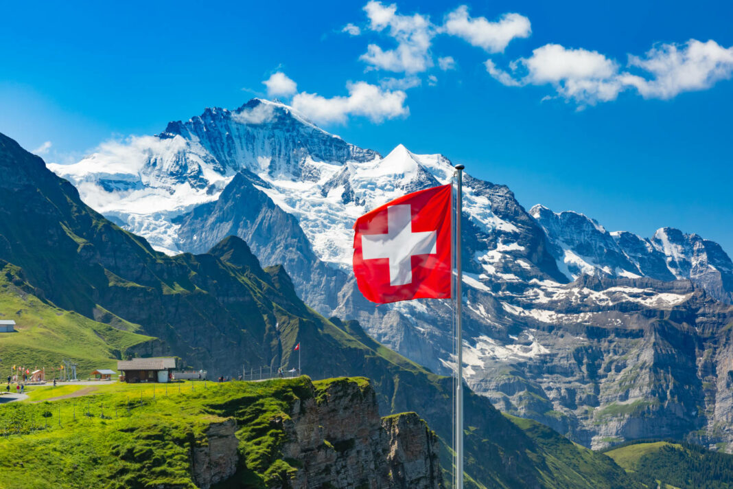 Swiss flag and tourists