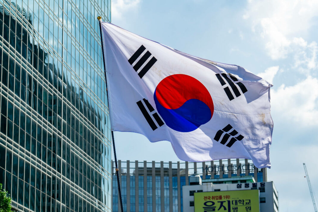 A large Republic of Korea flag fluttered at a parade in the streets of Seoul