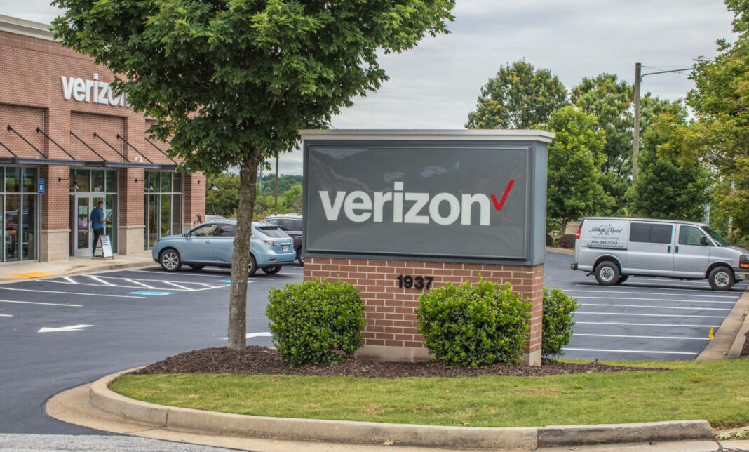 A Verizon sign in front of a parking lot for one of its buildings in Snellville