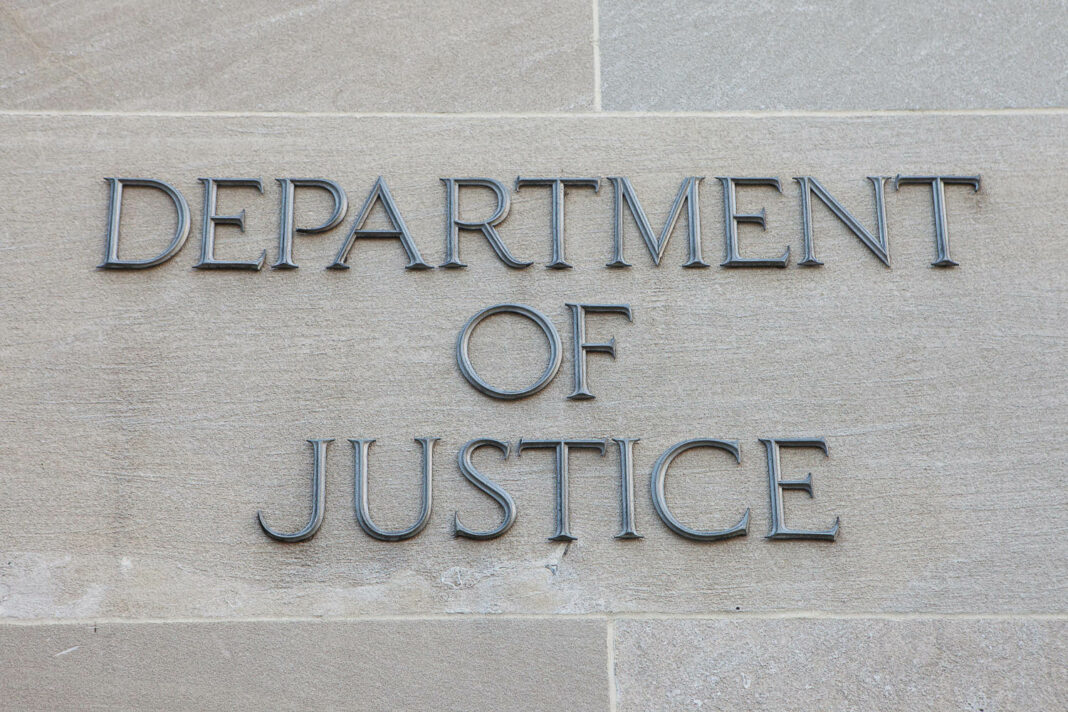 Sign of the Department of Justice (DOJ) in Washington, DC