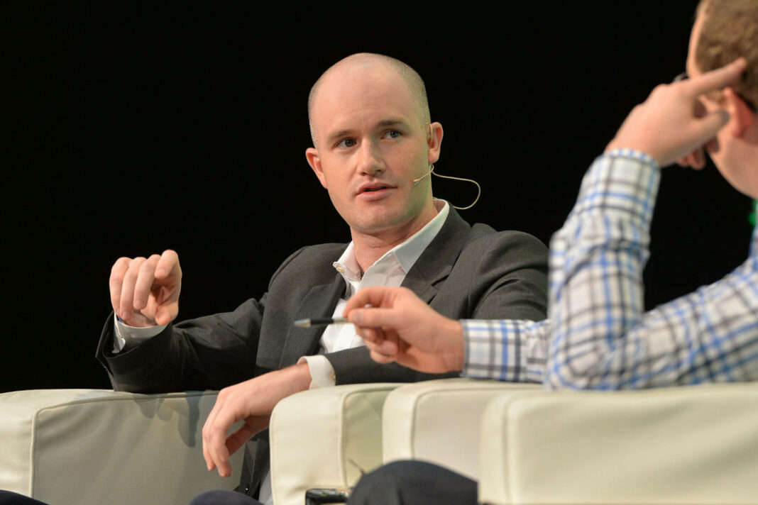 Coinbase CEO Brian Armstrong appears on stage at the 2014 TechCrunch Disrupt Europe/London