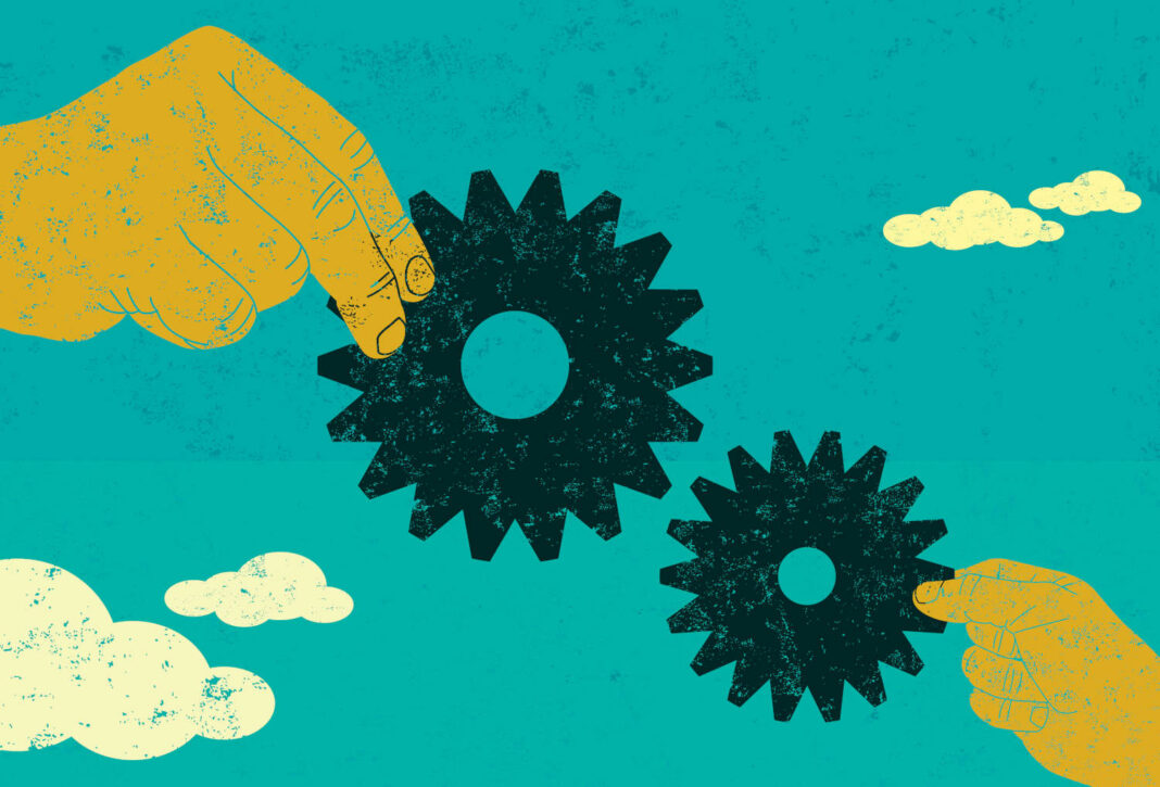 Hands hold gears illustration
