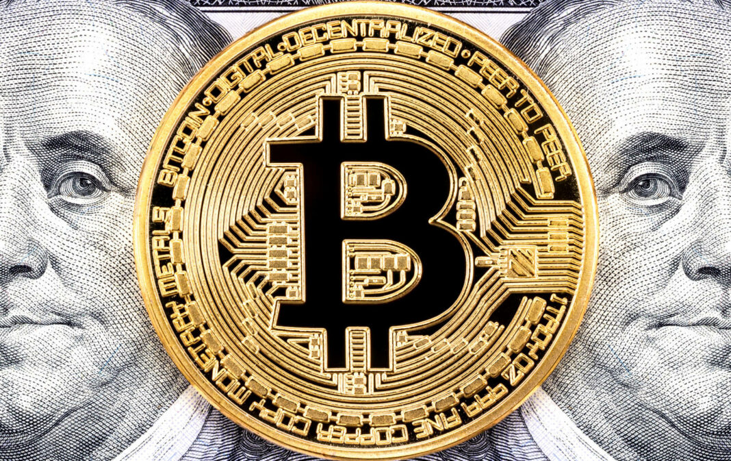 Bitcoin coin on top of dollars