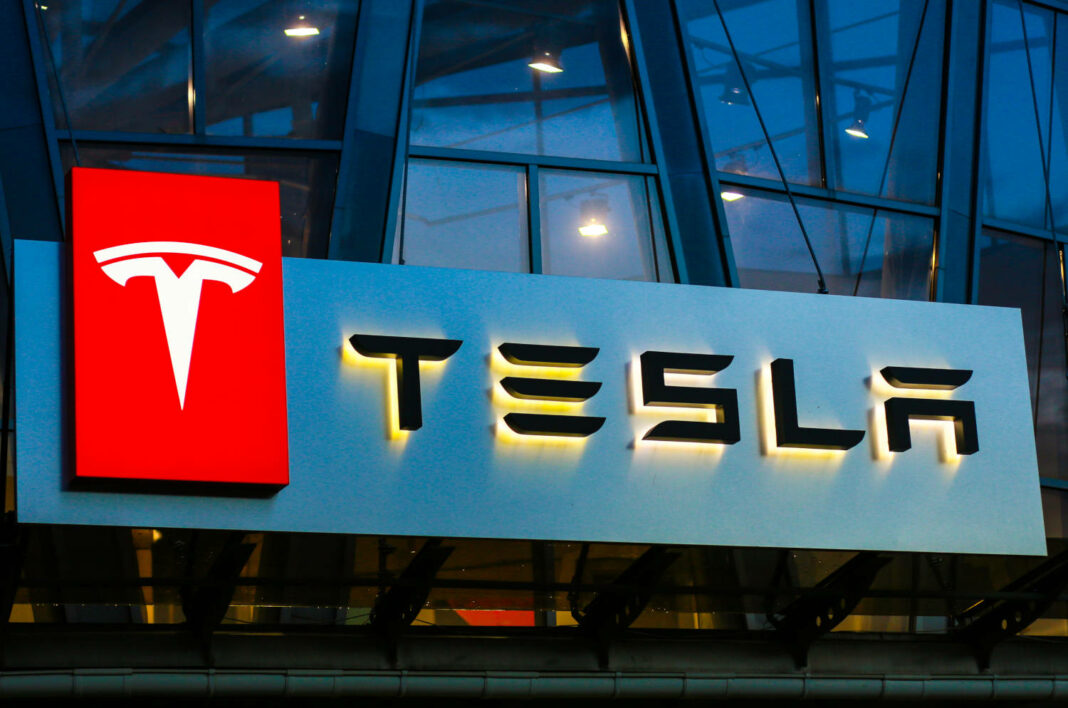 Tesla sign on a car sales building in Concha Zaspa