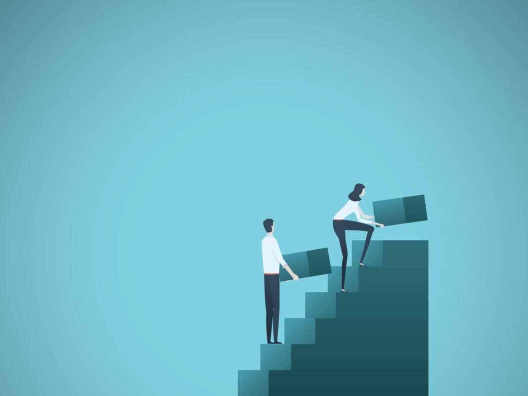 Man and woman climbing business stairs