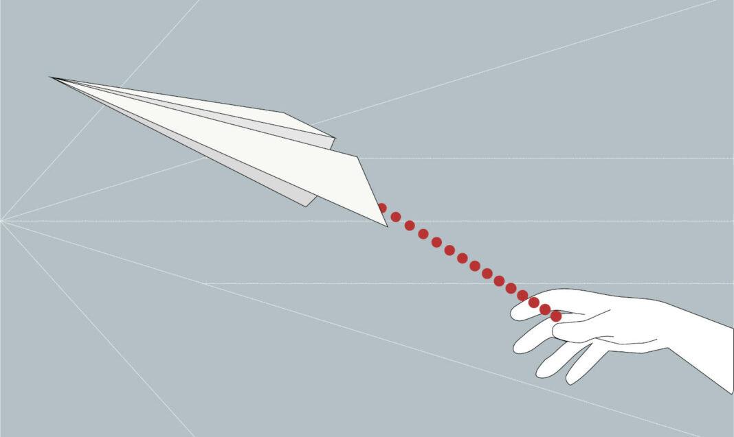 Hand throwing paper rocket