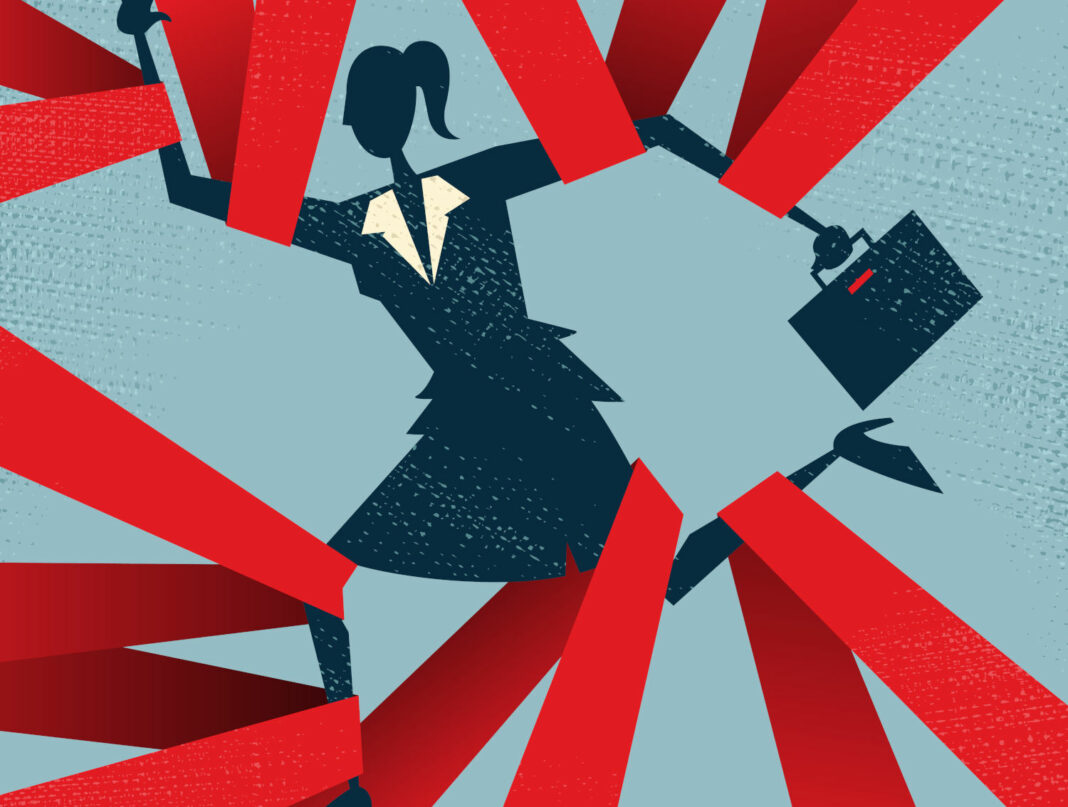 Businesswoman slowed down by red ribbons