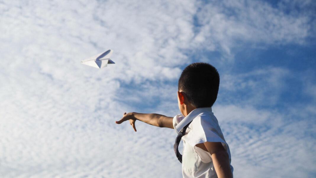 Kid throwing paper plane