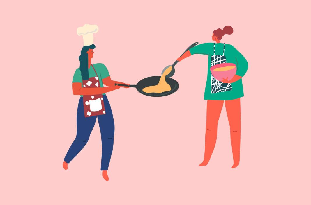 Women cooking pancakes