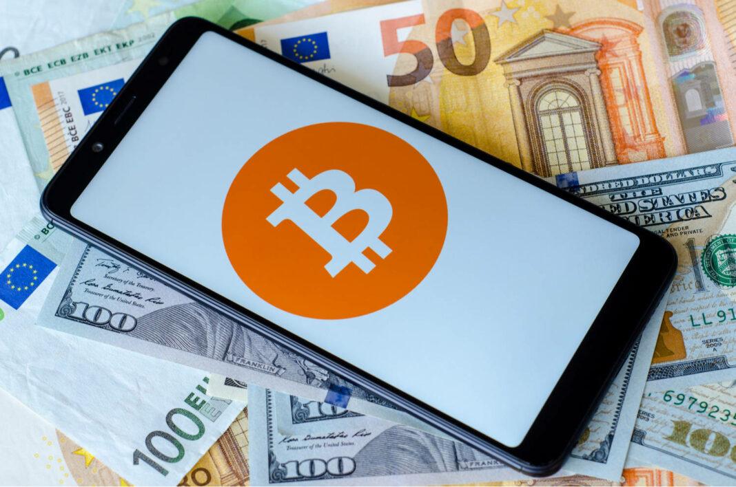 Bitcoin logo on smartphone