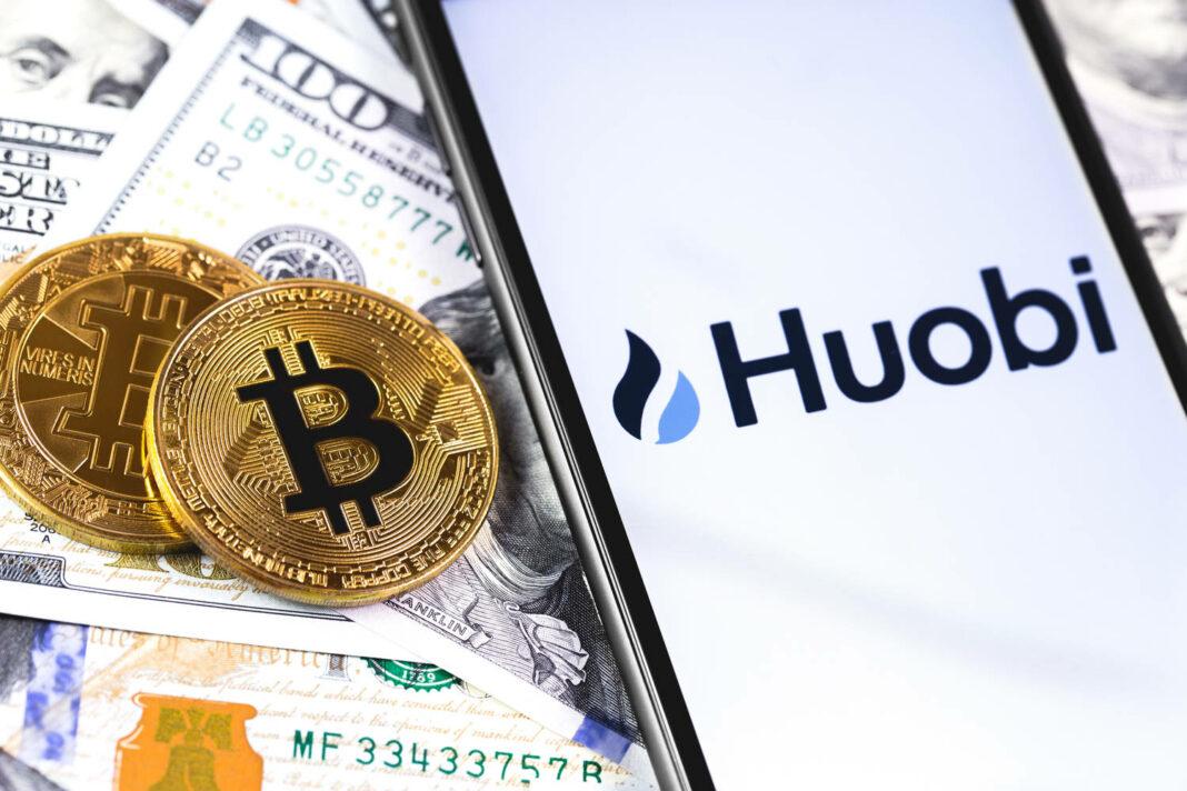 bitcoins, dollars and Huobi logo on the screen