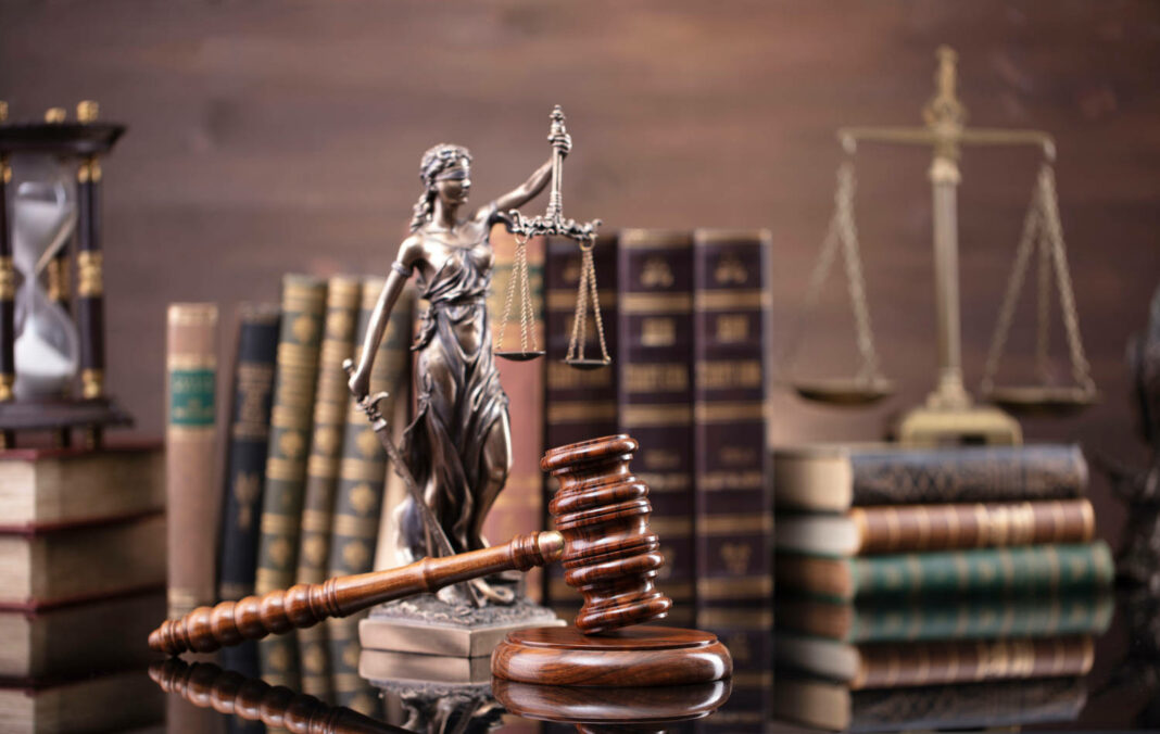 Justice symbols on glossy table