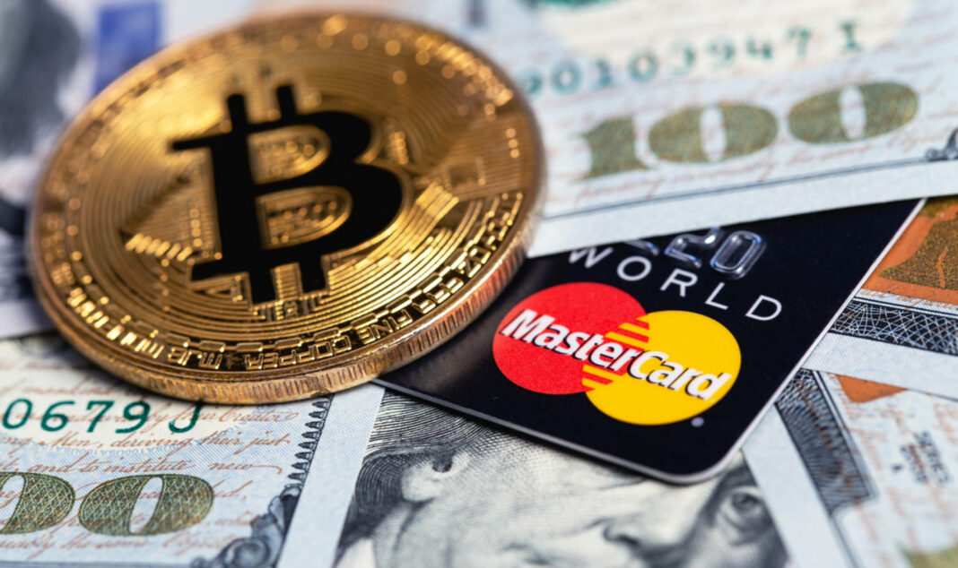 Bitcoin and MasterCard cards with money