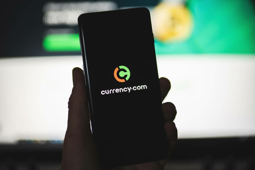 Smartphone with Currency.com logo