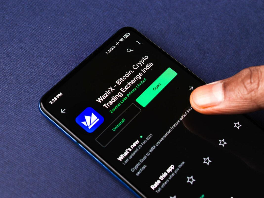 Wazirx logo on phone screen