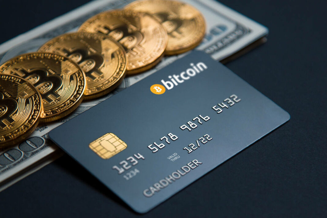Debit card with bitcoin on a dark background