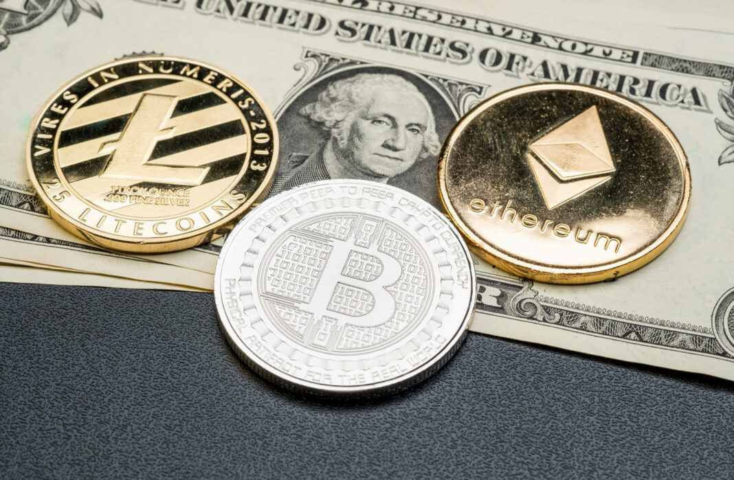 Silver and gold Bitcoin,litecoin,ethereum on dollar banknote