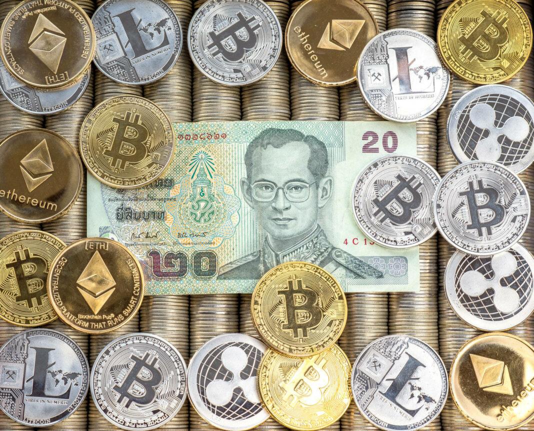 ETH, Ripple XRP, Litecoin LTC, bitcoin BTC. Paper bills Thai baht.