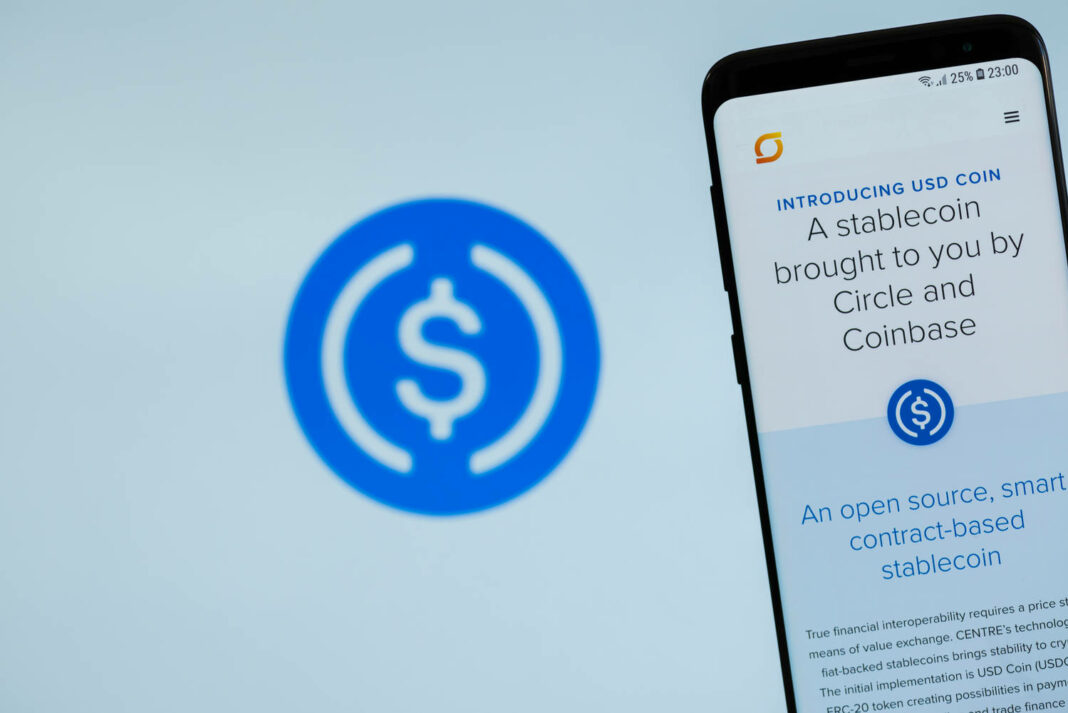 USDCoin website displayed on the smartphone screen