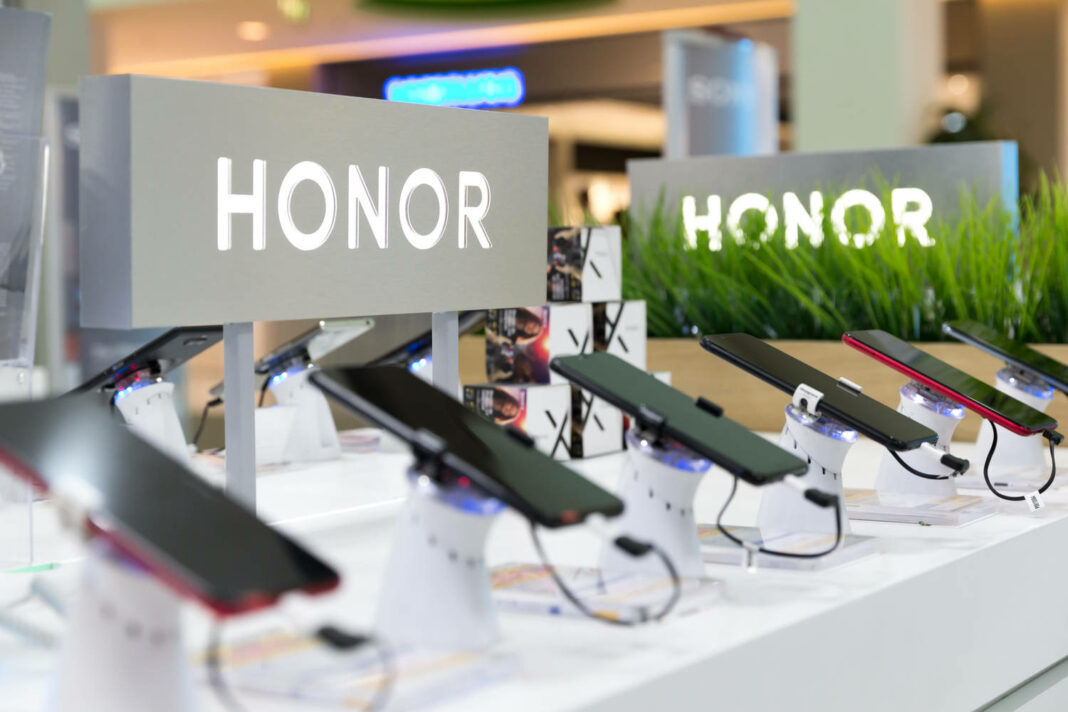 Honor mobile smartphones shown on retail display in electronic store