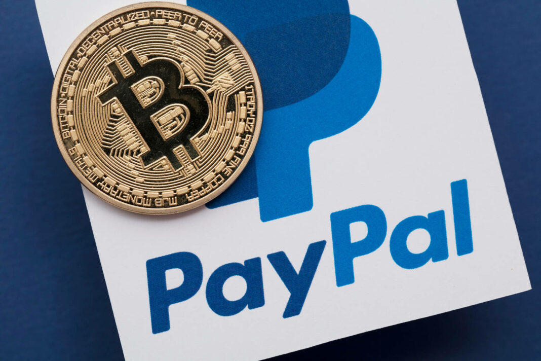 Bitcoin cryptocurrency on a paypal online payment logo