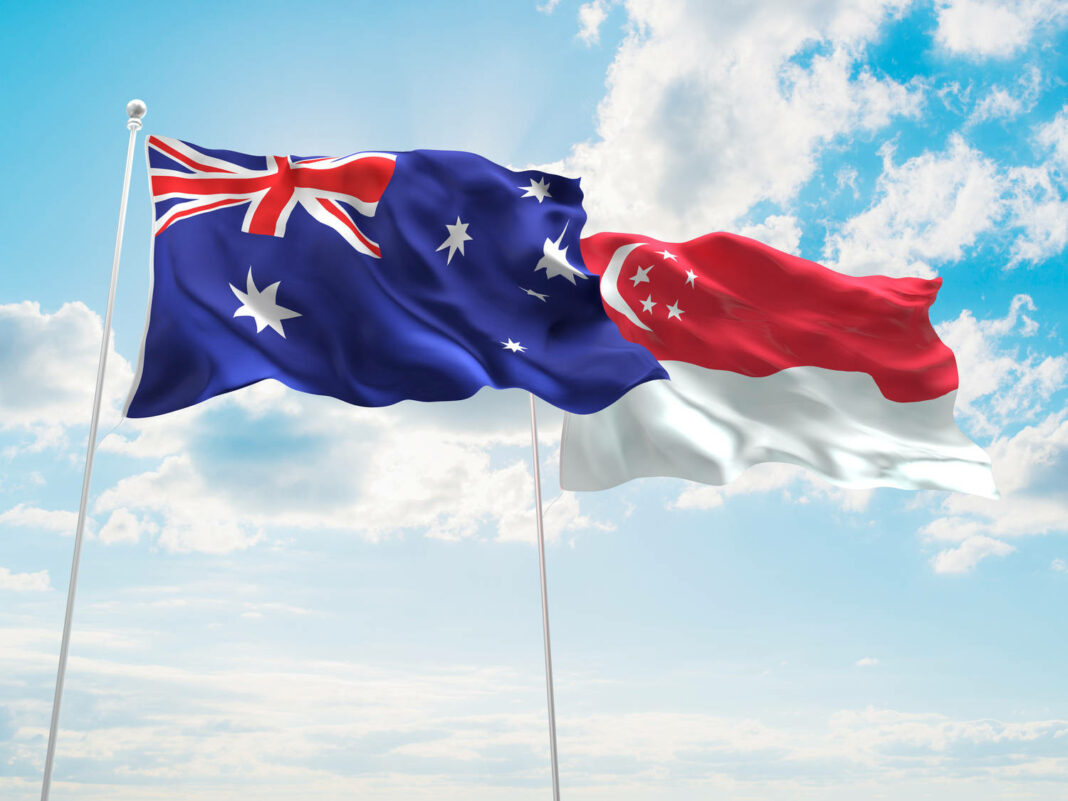 Australia & Singapore Flags are waving in the sky