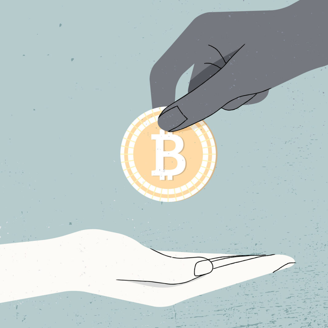 Hand holding Bitcoin and give it another hand