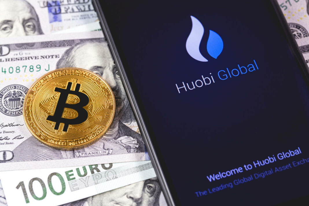 bitcoin, money and Huobi app on the screen smartphone