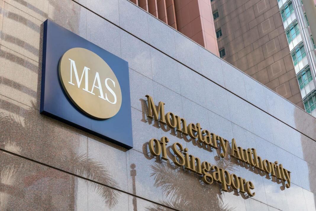 Monetary Authority of Singapore (MAS) logo signage on the building at entrance.