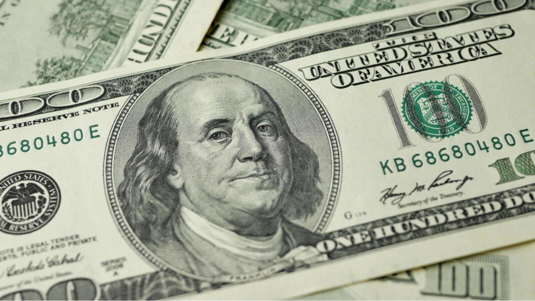 100 Dollars bill and portrait Benjamin Franklin on USA money banknote