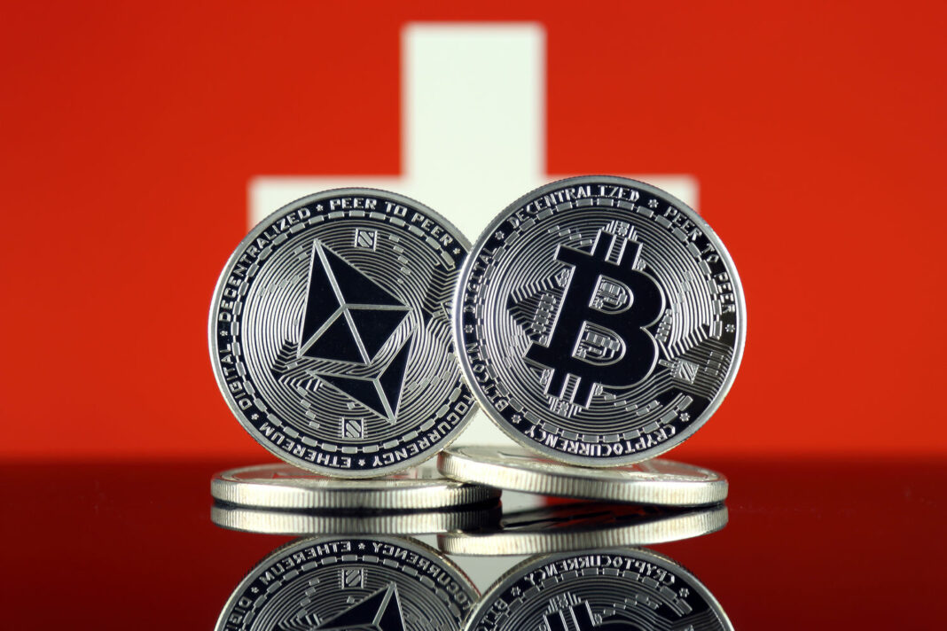 Physical version of Ethereum (ETH), Bitcoin (BTC) and Switzerland Flag